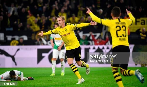 Dortmund's German forward Julian Brandt and Dortmund's Belgian forward Thorgan Hazard celebrate an offside goal during the German first division...