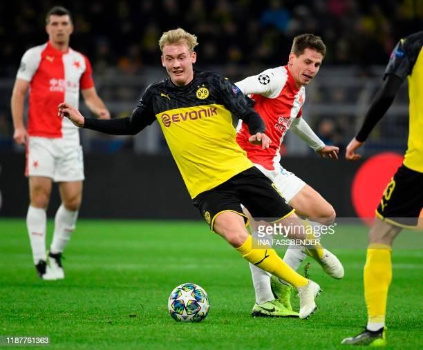 Dortmund's German forward Julian Brandt and Slavia Prague's Czech midfielder Lukas Masopust vie for the ball during the UEFA Champions League Group E...