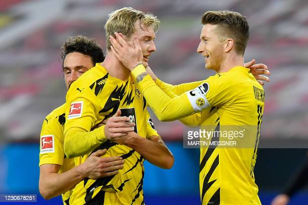 Dortmund's German forward Julian Brandt celebrates scoring the 1-1 goal with his team-mate Dortmund's German forward Marco Reus during the German...