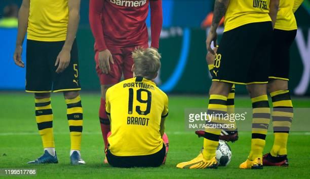 Dortmund's German forward Julian Brandt sits on the field after injury during the German first division Bundesliga football match Bayer 04 Leverkusen...