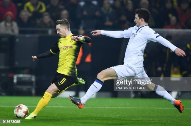 Dortmund's German forward Marco Reus and Bergamo's Mattia Caldara vie for the ball during the UEFA Europa League round of 32 first leg football match...