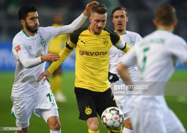 Dortmund's German forward Marco Reus and Bremen's Turkish forward Nuri Sahin vie for the ball during the German first division Bundesliga football...
