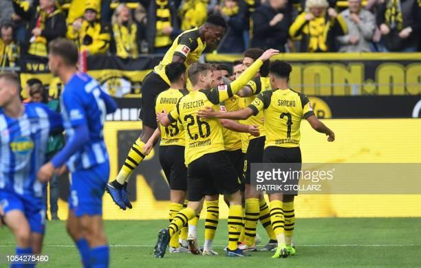 Dortmund's German forward Marco Reus and his teammates celebrate during the German first division Bundesliga football match Borussia Dortmund vs...