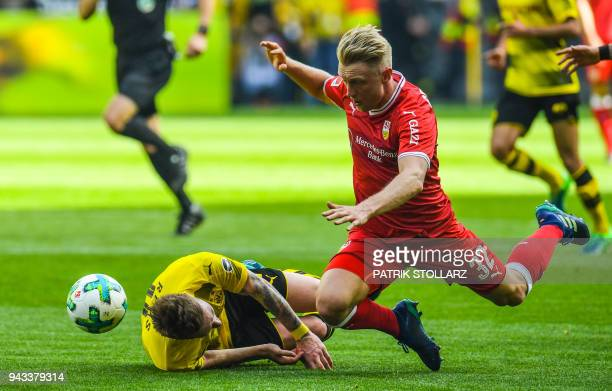 Dortmund's German forward Marco Reus and Stuttgart's German defender Andreas Beck vie for the ball during the German first division Bundesliga...