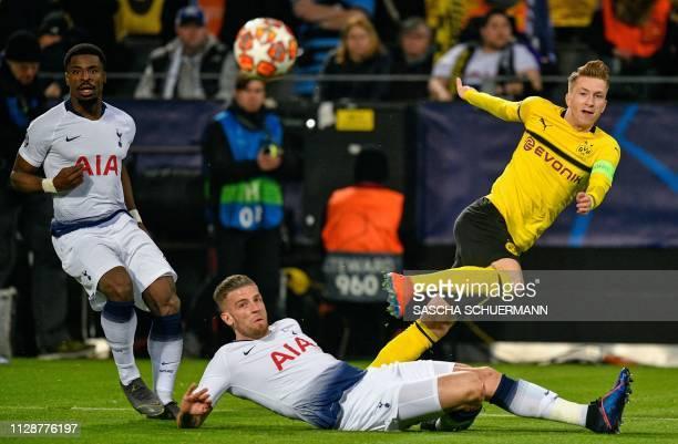 Dortmund's German forward Marco Reus and Tottenham Hotspur's Belgian defender Toby Alderweireld vie for the ball during the UEFA Champions League...