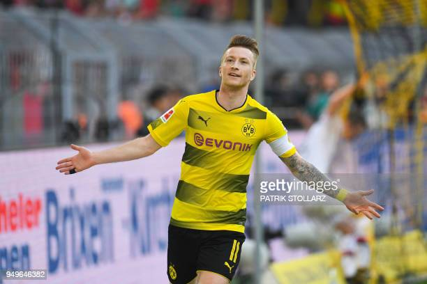 Dortmund's German forward Marco Reus celebrates after scoring during the German first division Bundesliga football match Borussia Dortmund vs Bayer...
