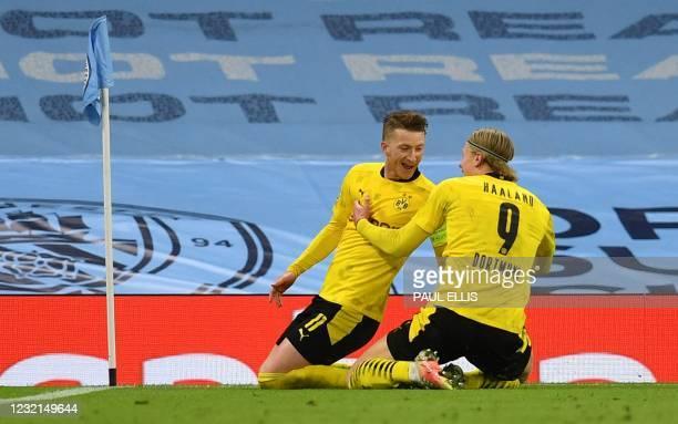 Dortmund's German forward Marco Reus celebrates after scoring the equalising goal with Dortmund's Norwegian forward Erling Braut Haaland during the...