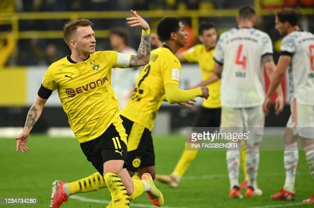 Dortmund's German forward Marco Reus celebrates scoring during the German Supercup football match BVB Borussia Dortmund vs FC Bayern Munich in...
