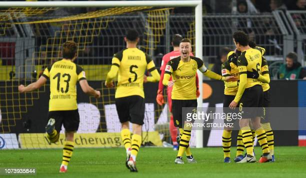 Dortmund's German forward Marco Reus celebrates with teammates during the German first division Bundesliga football match Borussia Dortmund vs Werder...