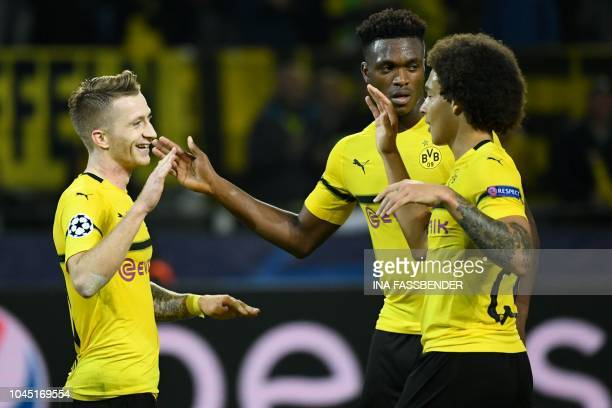 Dortmund's German forward Marco Reus Dortmund's French defender Abdou Diallo and Dortmund's Belgian midfielder Axel Witsel celebrate after the UEFA...
