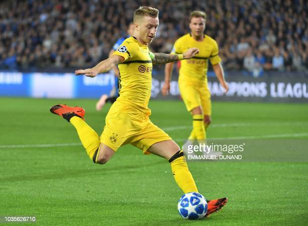 Dortmund's German forward Marco Reus kicks the ball during the UEFA Champions League Group C football match Club Brugge vs Borussia Dortmund at the...