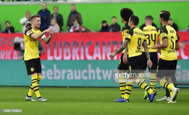 Dortmund's German forward Marco Reus reacts after scoring during the German First division Bundesliga football match between VfL Wolfsburg and...