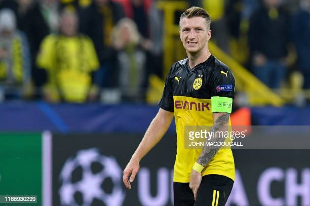 Dortmund's German forward Marco Reus reacts after the UEFA Champions League Group F football match Borussia Dortmund v FC Barcelona in Dortmund,...
