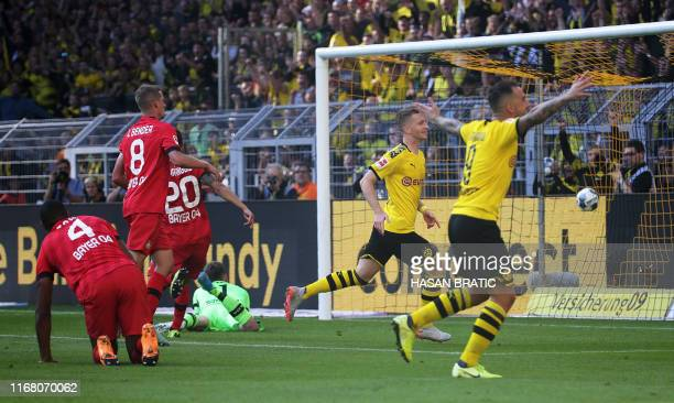 Dortmund's German forward Marco Reus scores 20 during the German first division Bundesliga football match BVB Borussia Dortmund v Bayer 04 Leverkusen...