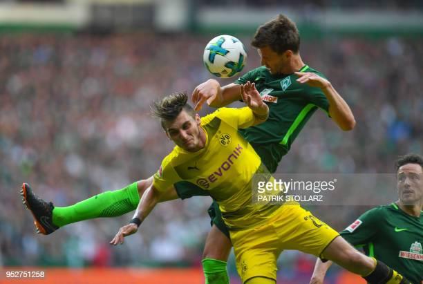 Dortmund's German forward Maximilian Philipp and Bremen's German defender Sebastian Langkamp vie for the ball during the German first division...