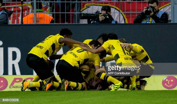 Dortmund's German forward Maximilian Philipp celebrate scoring the 10 goal with his teammates during the German first division Bundesliga football...