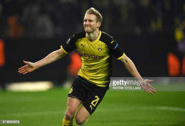 Dortmund's German midfielder Andre Schuerrle celebrates after scoring the 10 during the UEFA Europa League round of 32 first leg football match of...
