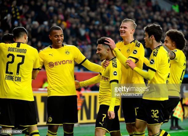 Dortmund's German midfielder Emre Can Dortmund's Swiss defender Manuel Akanji Dortmund's English forward Jadon Sancho Dortmund's Norwegian forward...