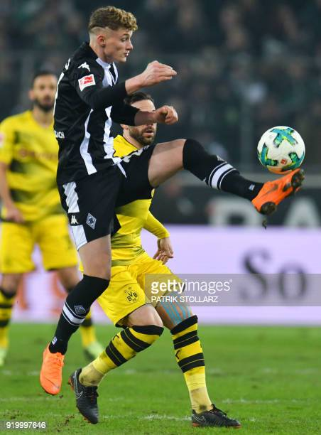 Dortmund's German midfielder Gonzalo Castro and Moenchengladbach's French midfielder Mickael Cuisance vie for the ball during the German first...