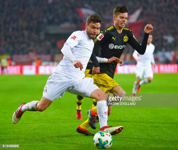 Dortmund's German midfielder Julian Weigl and Cologne's German defender Jonas Hector vie for the ball during the German first division Bundesliga...