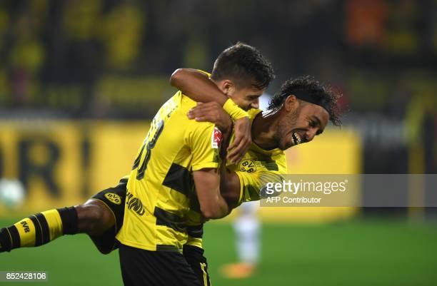 Dortmund's German midfielder Julian Weigl celebrates scoring with Gabonese striker PierreEmerick Aubameyang during the German First division...