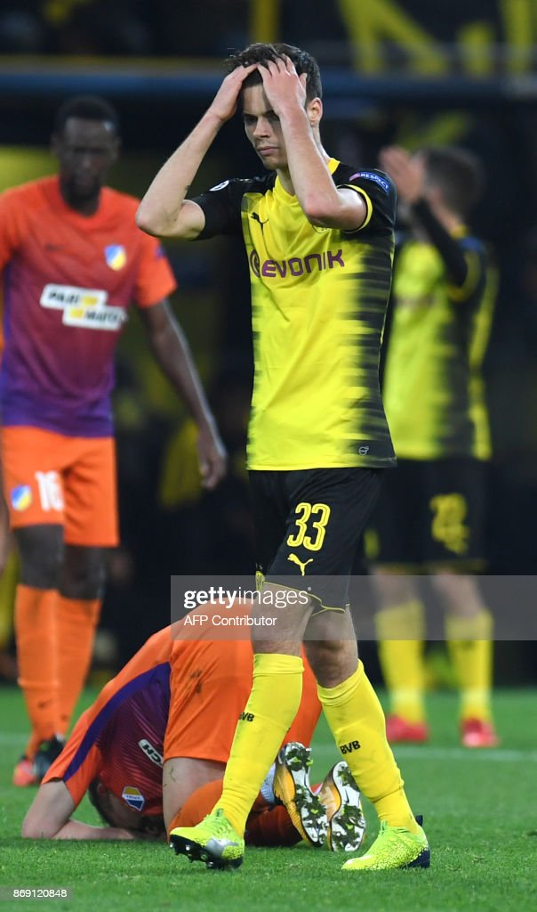 Dortmund's German midfielder Julian Weigl reacts during the UEFA Champions League Group H football match BVB Borussia Dortmund v Apoel Nicosia on November 1, 2017 in Dortmund, western Germany. /
