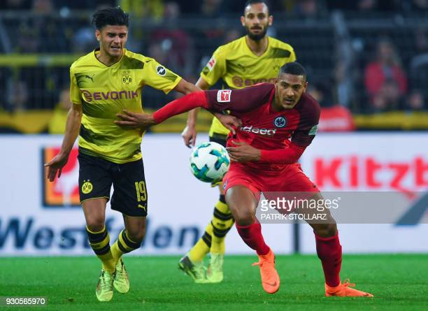 Dortmund's German midfielder Mahmoud Dahoud and Frankfurt's French forward Sebastien Haller vie for the ball during the German first division...