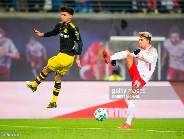 Dortmund's German midfielder Mahmoud Dahoud and Leipzig's Slovanian midfielder Kevin Kampl vie for the ball during the German first division...
