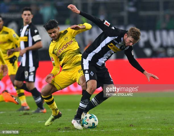 Dortmund's German midfielder Mahmoud Dahoud and Moenchengladbach's German midfielder Christoph Kramer vie for the ball during the German first...