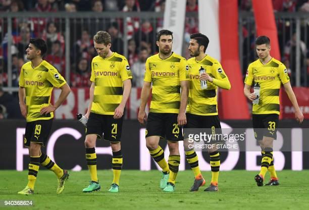 Dortmund's German midfielder Mahmoud Dahoud Dortmund's German midfielder Andre Schuerrle Dortmund's Greece defender Sokratis Dortmund's Turkish...