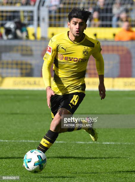Dortmund's German midfielder Mahmoud Dahoud plays the ball during the German first division Bundesliga football match Borussia Dortmund vs Hanover 96...