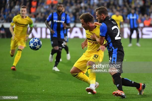Dortmund's German midfielder Mario Goetze vies with Club Brugge's Belgian midfielder Mats Rits during the UEFA Champions League Group C football...