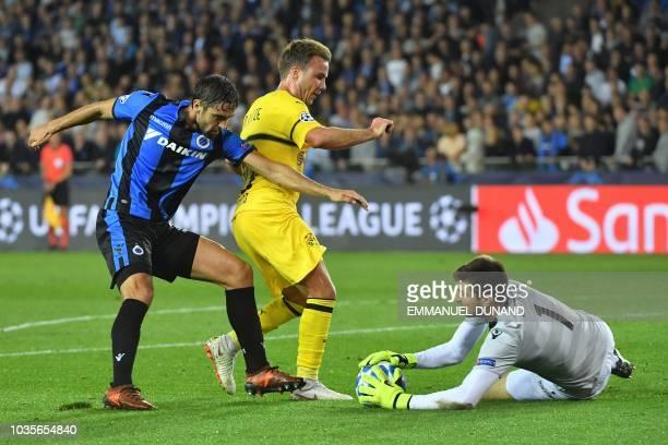 Dortmund's German midfielder Mario Goetze vies with Club Brugge's Croatian goalkeeper Karlo Letica and Club Brugge's French defender Benoit Poulain...