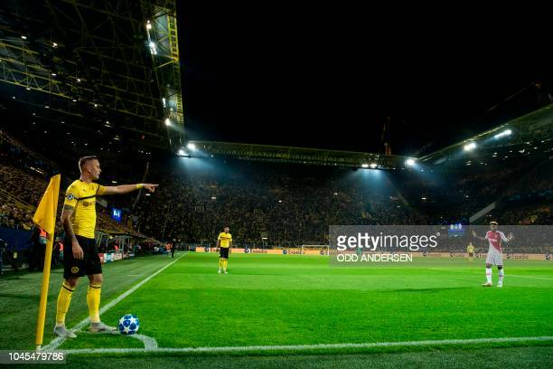 Dortmund's German midfielder Marius Wolf prepares a corner kick during the UEFA Champions League Group A football match BVB Borussia Dortmund v AS...