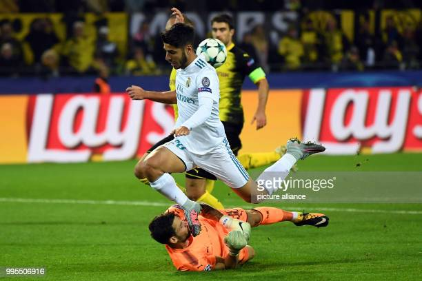 Dortmund's goalkeeper Roman Buerki is kicked in the face by Madrid's Marco Asensio during the UEFA Champions League football match between Borussia...