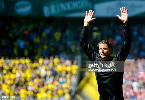 Dortmund's goalkeeper Roman Weidenfeller bids farewell to supporters as he leaves the club at the end of the German first division Bundesliga...