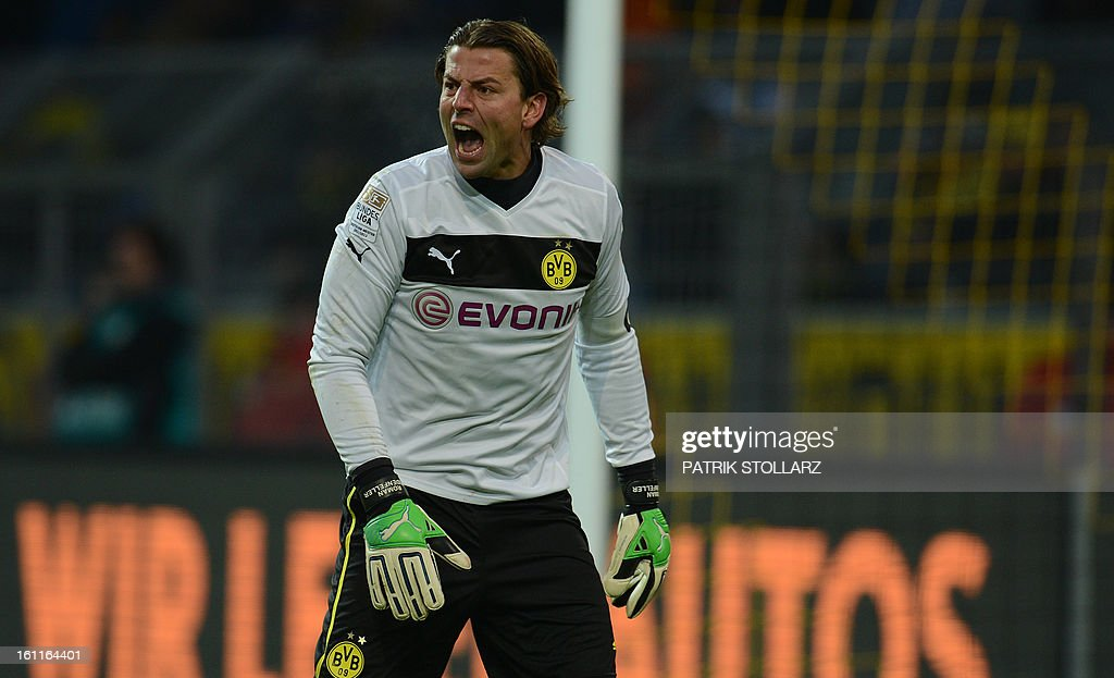 Dortmund's goalkeeper Roman Weidenfeller reacts during the German first division Bundesliga football match Borussia Dortmund vs Hamburger SV in Dortmund, western Germany, on February 9, 2013. Hamburg won 1-4.