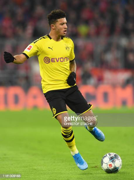 Dortmund's Great Britain midfielder Jardon Sancho plays the ball during the German first division Bundesliga match between FC Bayern Munich and...