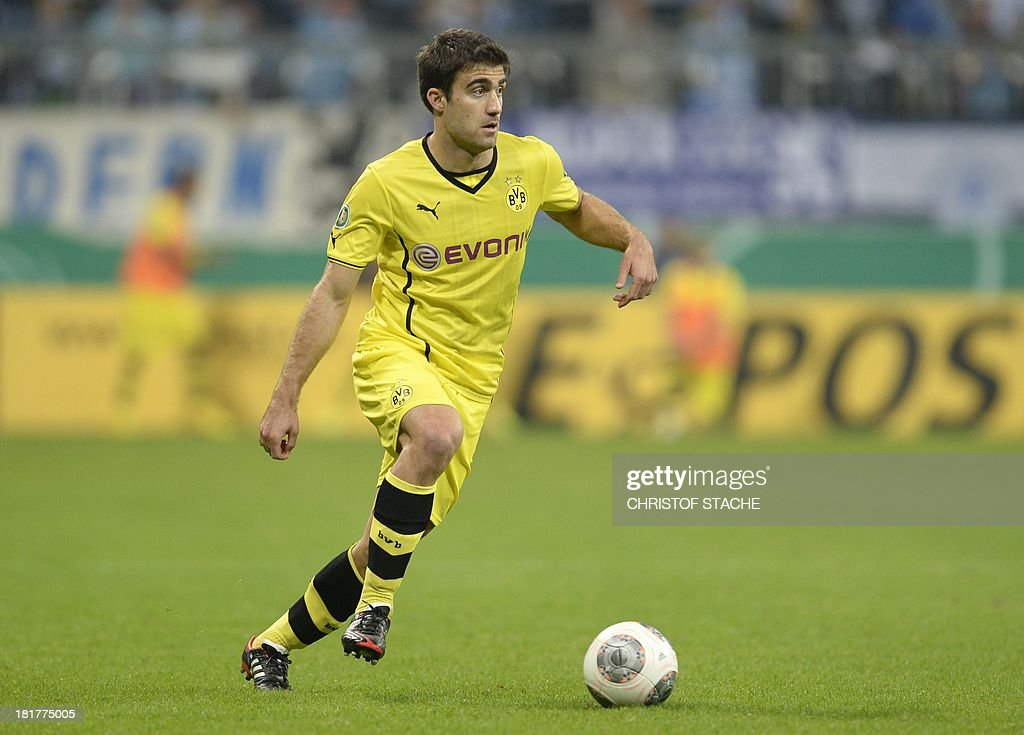 Dortmund's Greece defender Sokratis plays the ball during the second round football match of the German Cup (DFB - Pokal) TSV 1860 Munich vs Borussia Dortmund on September 24, 2013 in Munich, southern Germany. STACHE