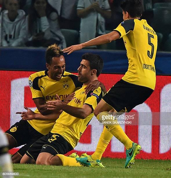Dortmund's Greek defender Sokratis celebrates scoring his team's second goal with Dortmund's Gabonese forward PierreEmerick Aubameyang and Dortmund's...