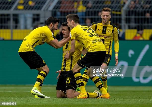 Dortmund's Greek defender Sokratis celebrates scoring with teammates during the German First division Bundesliga football match between Borussia...