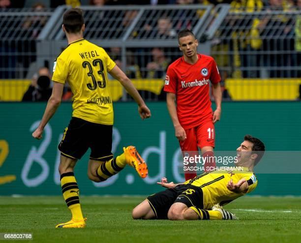 Dortmund's Greek defender Sokratis Papastathopoulos celebrates scoring the 21 with his teammates during the German First division Bundesliga football...