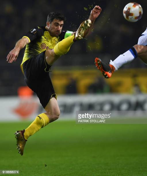 Dortmund's Greek defender Sokratis plays the ball during the UEFA Europa League round of 32 first leg football match of Germany's Borussia Dortmund...