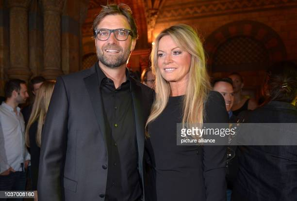 Dortmund's head coach Jürgen Klopp and his wife Ulla during the club's after party at Natural History Museum in London England 26 May 2013 Borussia...