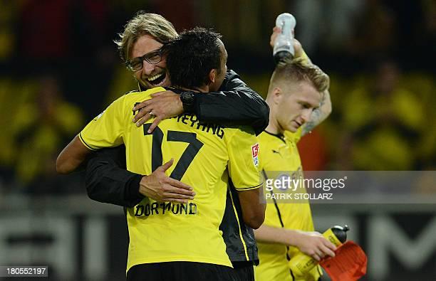 Dortmund's head coach Juergen Klopp and Dortmund's Gabonese striker PierreEmerick Aubameyang celebrate after winning the German first division...