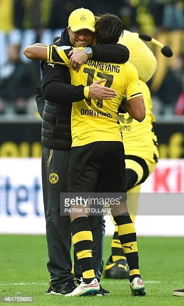 Dortmund's head coach Juergen Klopp and Dortmund's Gabonese striker PierreEmerick Aubameyang celebrate after the German first division Bundesliga...