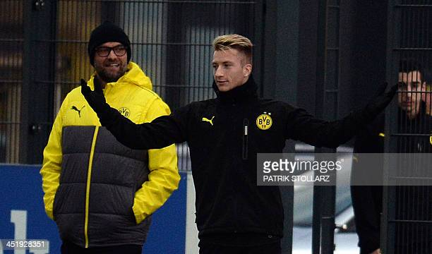 Dortmund's head coach Juergen Klopp and Dortmund's striker Marco Reus attend a training session at the training ground in DortmundBrackel western...