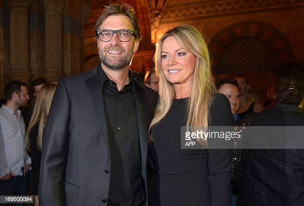 Dortmund's head coach Juergen Klopp and his wife Ulla pose for a picture during the after party of the final European Champions League football match...