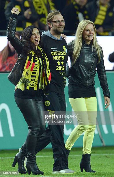 Dortmund's head coach Juergen Klopp celebrates with his wife Ulla and Dortmund's manager's wife Jola Zorc after the German first division Bundesliga...