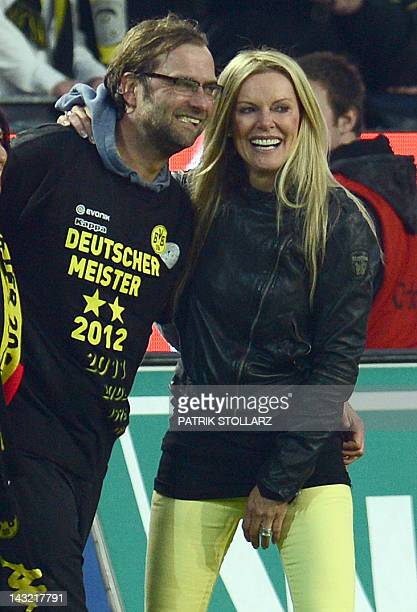 Dortmund's head coach Juergen Klopp celebrates with his wife Ulla after the German first division Bundesliga football match Borussia Dortmund vs...